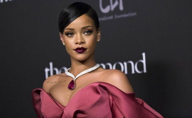 Singer Rihanna poses at the First Annual Diamond Ball fundraising event at The Vineyard in Beverly Hills, California Dec 11, 2014. REUTERS