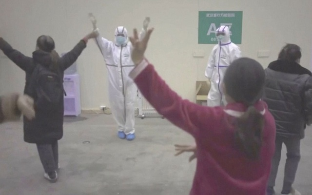 Coronavirus patients and medical staff dance to a lively Chinese song about red flowers at a makeshift hospital in Wuhan, China in this still frame obtained from video dated Feb 10, 2020. REUTERS