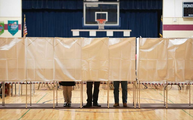 People vote in the New Hampshire primary at Rye Elementary School in Rye, NH, on Tuesday, Feb 11, 2020. A startup says it has developed a smartphone tool through which voters can cast ballots anywhere, but researchers say the app is riddled with security flaws. The New York Times