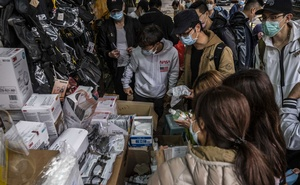People shop for face masks and other items at a Hong Kong store on Thursday, Feb 13, 2020. The coronavirus, which surfaced in a Chinese seafood and poultry market late last year, has spread to numerous countries. (Lam Yik Fei/The New York Times)
