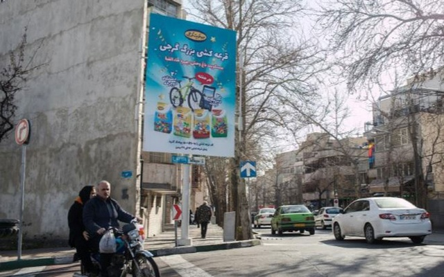 A billboard ad for Gorji Biscuits on a street in Tehran, Iran, Feb. 7, 2020. The rise of Iran's stock market attests to the wealth within the country, and the resourcefulness of its companies as they confront American sanctions. (Arash Khamooshi/The New York Times)