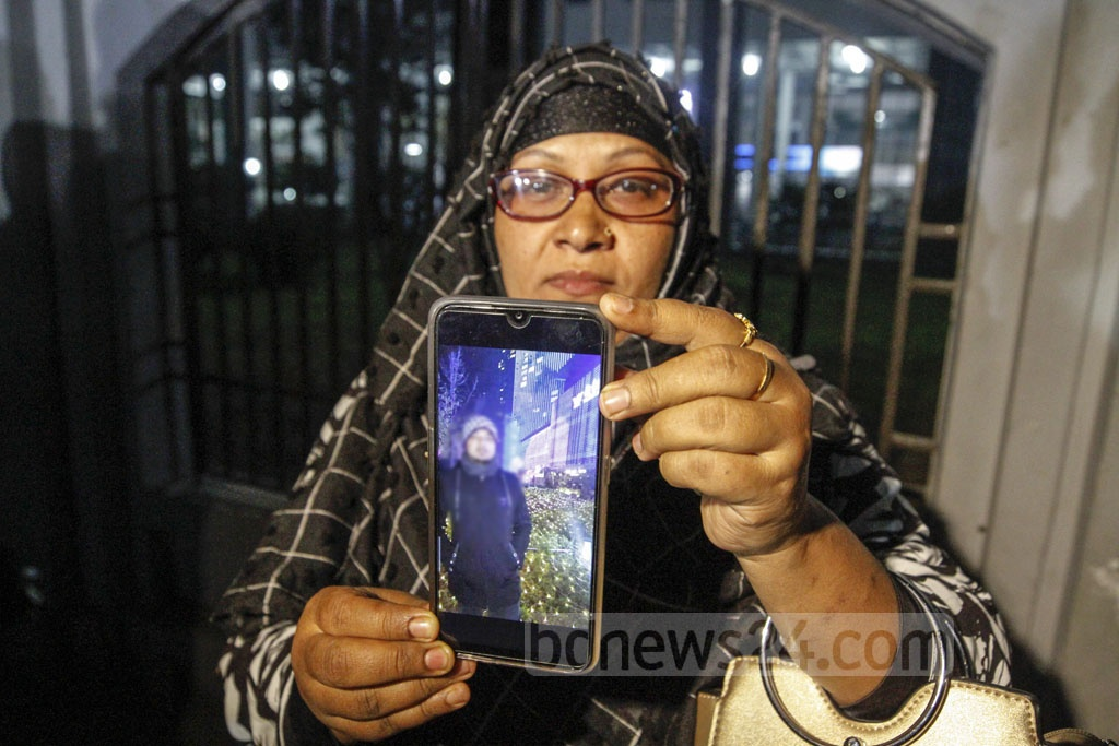 Many relatives showed photos of the evacuees from Wuhan, the Chinese city at the heart of a deadly coronavirus outbreak, while waiting for their release from the Ashkona Hajj Camp, a facility used for close surveillance of the returnees in isolation for two weeks.