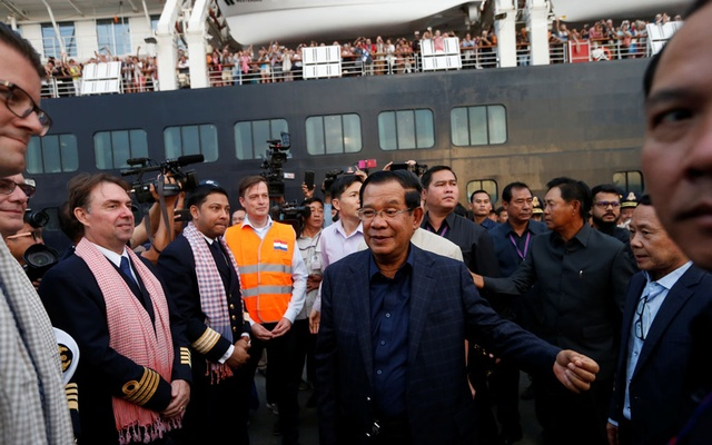 Cambodia's Prime Minister Hun Sen welcomes crews of MS Westerdam, a cruise ship that spent two weeks at sea after being turned away by five countries over fears that someone aboard might have the coronavirus, as it docks in Sihanoukville, Cambodia February 14, 2020. Reuters