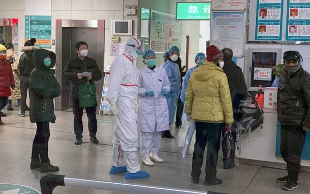 Patients wait to see doctors at No 9 Hospital in Wuhan, China, on Thursday, Jan 23, 2020, where the medical staff are all wearing heavily protective clothing. The New York Times