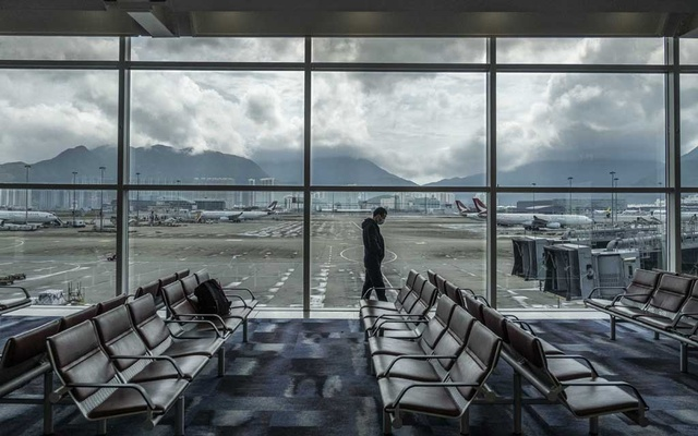 A man walks by windows at Hong Kong International Airport on Friday, Feb 14, 2020. China on Friday reported 5,090 new coronavirus cases and 121 new deaths in the previous 24 hours. The New York Time