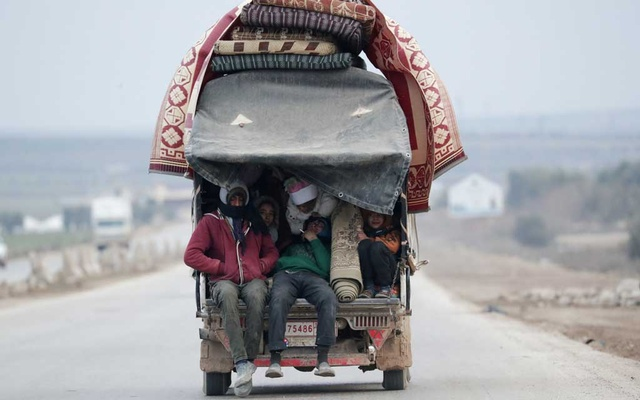 Internally displaced people, who fled from Idlib, are pictured inside a truck in Azaz, Syria Feb 15, 2020. REUTERS