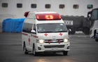 Ambulance workers wearing protective suits leave the quarantined Diamond Princess cruise ship, as the vessel's passengers continue to be tested for coronavirus, at Daikoku Pier Cruise Terminal in Yokohama, south of Tokyo, Japan February 16, 2020. REUTERS