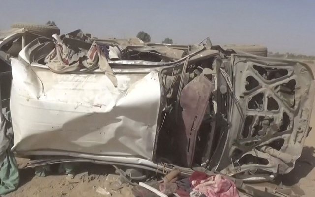 A destroyed vehicle is seen after an air strike in Al-Jawf province, Yemen, Feb 15, 2020 in this still image taken from a video. REUTERS