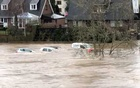 Cars are swept away by floodwaters after the River Wye broke its banks, in Hay-on-Wye, Wales, Britain Feb 16, 2020 in this screen grab obtained from a social media video. Jonathan Sayce/via REUTERS