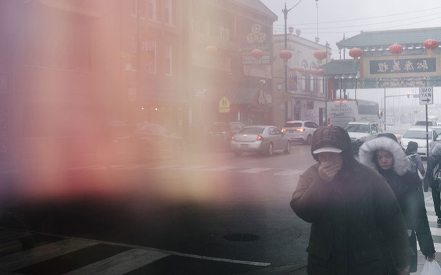 People walk in Chicago's Chinatown neighborhood, on Feb. 12, 2020. Many Asian-Americans said they had noticed an unnerving level of public scrutiny lately, a simple cough or sneeze can send people nearby scattering, some said. (David Kasnic/The New York Times)