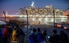 A bus arrives near the cruise ship Diamond Princess, where dozens of passengers were tested positive for coronavirus, at Daikoku Pier Cruise Terminal in Yokohama, south of Tokyo, Japan, Feb 16, 2020. REUTERS