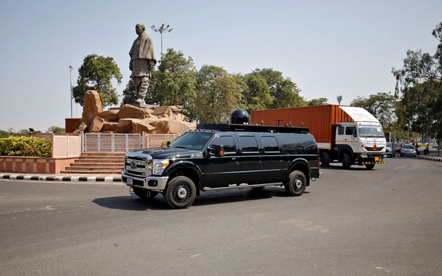 A US government vehicle and other supply trucks drive past a statue of Sardar Vallabhbhai Patel after arrival at Sardar Vallabhbhai Patel International Airport, ahead of the President Donald Trump's visit to India, in Ahmedabad, India, Feb 17, 2020. REUTERS