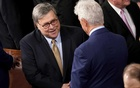 Attorney General William Barr, left, greets members of senate at President Donald Trump's State of the Union speech, on Capitol Hill in Washington, Feb 4, 2020.
