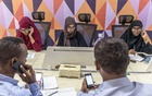 Dr Amina Abdulkadir Isack, right, and other volunteers set up a phone bank to contact families and friends of the victims, in Mogadishu, Somalia on Jan 1, 2020, after a truck bombing killed 82 people and injured 150. The New York Times