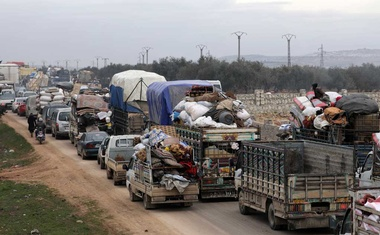 A general view of vehicles carrying belongings of internally displaced Syrians from western Aleppo countryside, in Hazano near Idlib, Syria, Feb 11, 2020. REUTERS