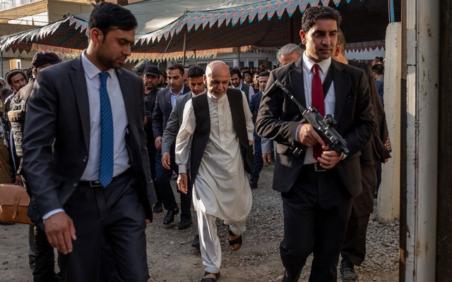 FILE - Afghan President Ashraf Ghani, center, walks with security at a campaign rally in Kabul, Afghanistan on Sept. 10, 2019. Ghani was declared the winner of Afghanistan's presidential vote after months of delayed results and bitter dispute on Feb. 18, 2020. (Jim Huylebroek/The New York Times)