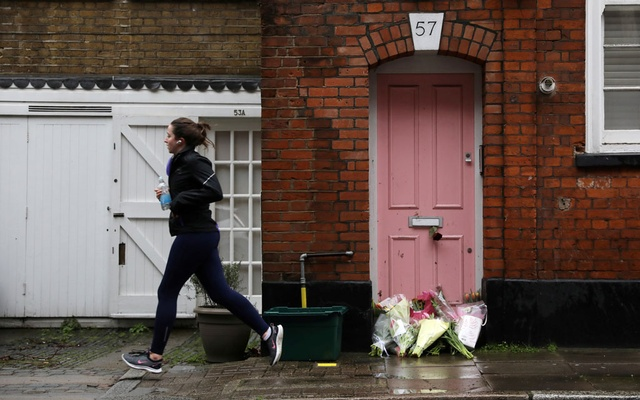 Flowers lie outside British television presenter Caroline Flack's old house in Islington, London, Feb 16, 2020. REUTERS