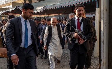 Afghan President Ashraf Ghani, centre, walks with security at a campaign rally in Kabul, Afghanistan on Sept 10, 2019. The New York Times