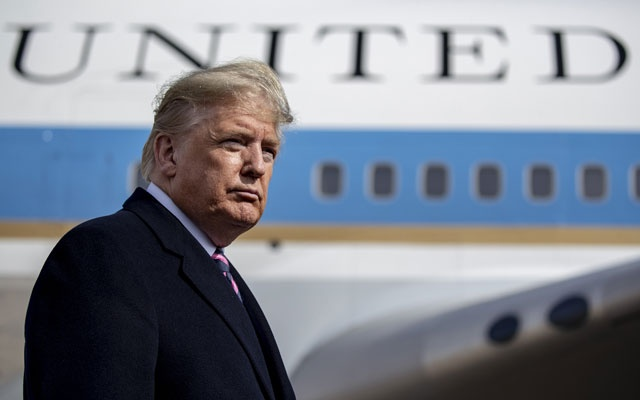 President Donald Trump talks with reporters at Joint Base Andrews in Maryland where he announced he commuted the corruption sentence of former Gov Rod Blagojevich of Illinois, before departing on a trip to California, Tuesday, Feb 18, 2020. The New York Times