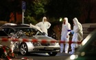 Forensic experts work around a damaged car after a shooting in Hanau near Frankfurt, Germany, Feb 20, 2020. REUTERS