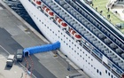 Passengers disembarking from the Diamond Princess cruise ship docked at Yokohama Port are pictured in Yokohama, south of Tokyo, Japan, Feb 19, 2020. Kyodo via REUTERS