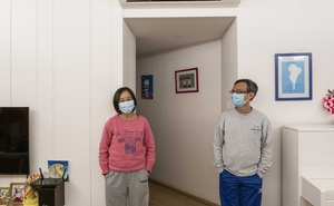 Drs Eunice and Pierre Chan wear masks at home in Hong Kong, China on Feb 18, 2020. The New York Times
