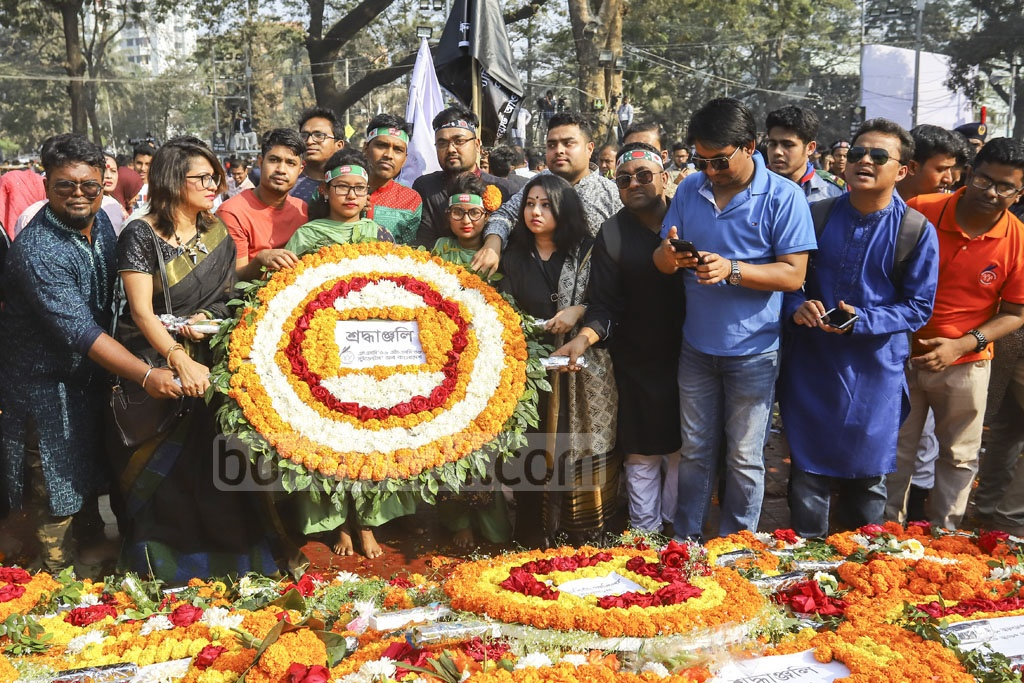 Different organisations paying homage to Language Movement martyrs at the Central Shaheed Minar in Dhaka on Friday. Photo: Asif Mahmud Ove