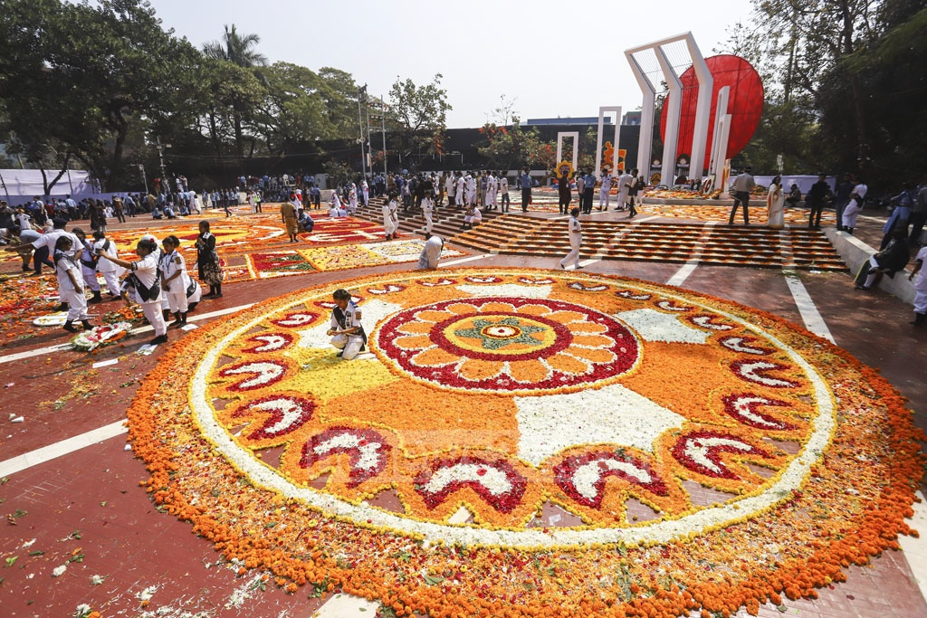 The altar of the Central Shaheed Minar in Dhaka is decorated with flowers as the nation pays tribute of respect on the Language Movement Day on Friday. Photo: Asif Mahmud Ove