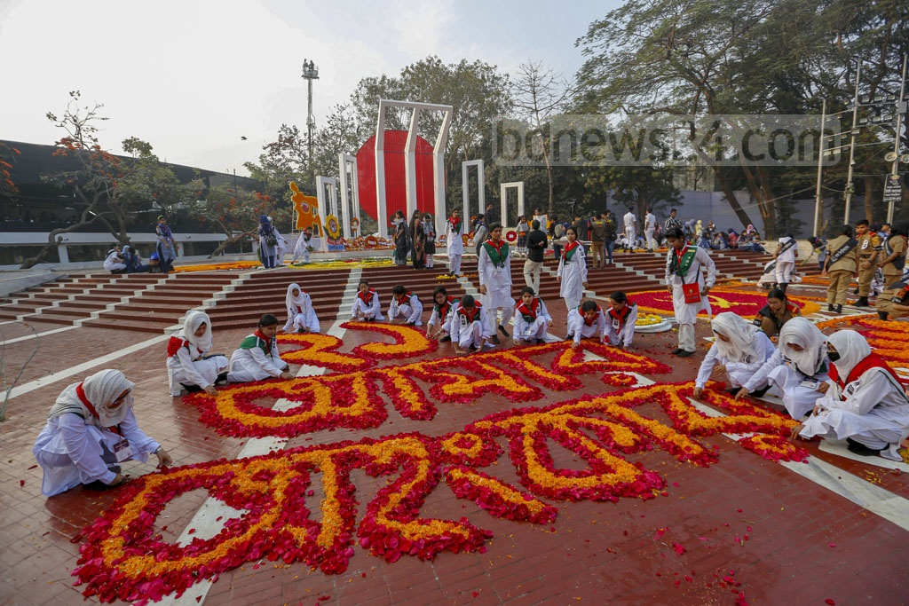 The altar of the Central Shaheed Minar in Dhaka is decorated with flowers as the nation pays tribute of respect on the Language Movement Day on Friday. Photo: Mahmud Zaman Ovi