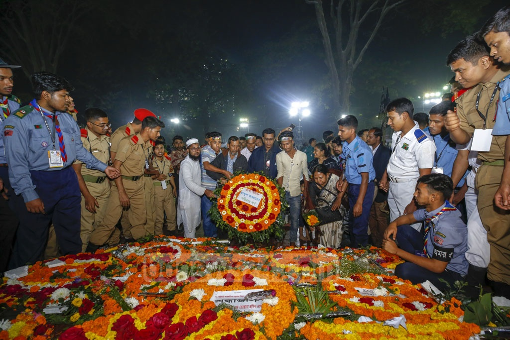 Different organisations paying homage to Language Movement martyrs at the Central Shaheed Minar in Dhaka on Friday. Photo: Mahmud Zaman Ovi