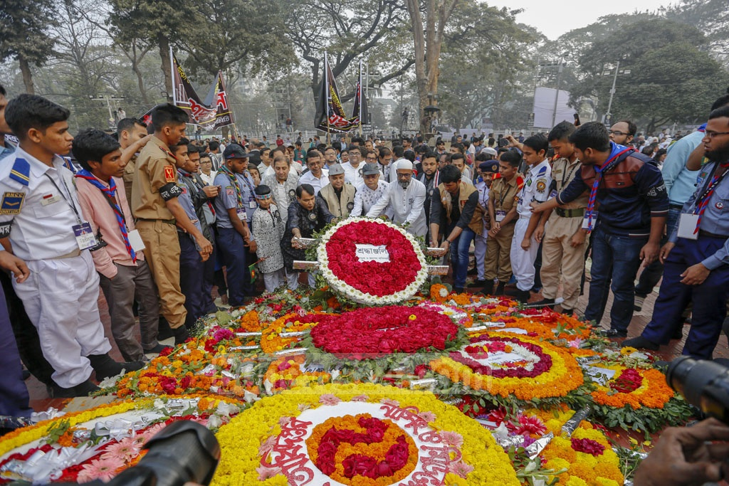 Different organisations paying respects to Language Movement martyrs at the Central Shaheed Minar in Dhaka on Friaday. Photo: Mahmud Zaman Ovi