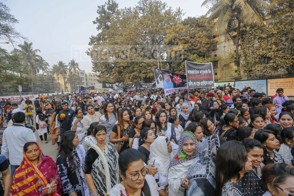 People from all walks of life marching towards the Central Shaheed Minar in Dhaka to pay their respects to the Language Movement martyrs on Friday. Photo: Mahmud Zaman Ovi