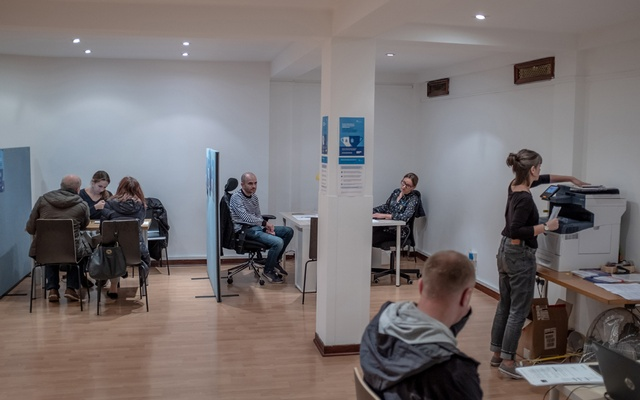 People visit the East European Resource Centre in London on Oct 26, 2019. England's new minimum salary requirements in its immigration system would particularly affect female migrants, who tend to cluster in lower-paid occupations. The New York Times