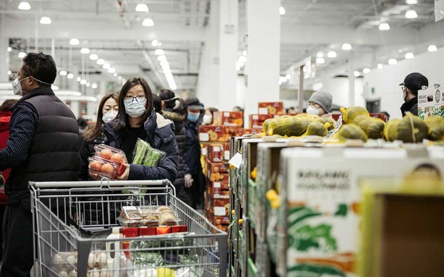 People wearing masks, shop in Shanghai, China on Feb 8, 2020. The New York Times