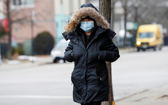 A woman wears a mask in Chinatown following the outbreak of the novel coronavirus, in Chicago, Illinois, US January 30, 2020. REUTERS