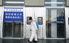 A worker sprays disinfectant at the entrance of Beijing West railway station in an effort to protect against the coronavirus on Monday, Feb 10, 2020. The New York Times