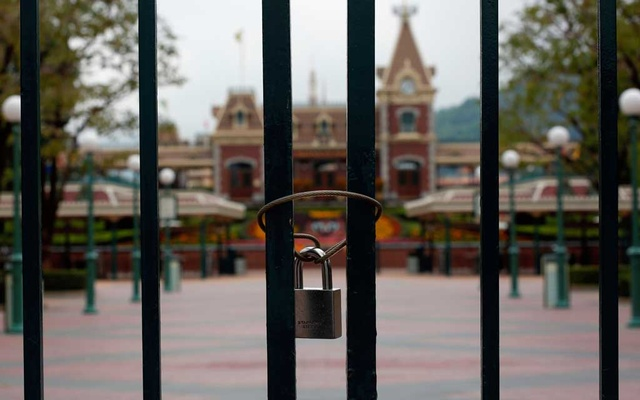 A locked gate is seen after the Hong Kong Disneyland theme park has been closed, following the coronavirus outbreak in Hong Kong, China January 26, 2020. Reuters