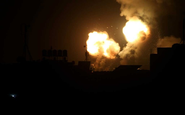 Flame and smoke are seen during Israeli air strikes in the southern Gaza Strip Feb 23, 2020. REUTERS