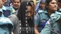 Police escorting Shamima Noor Papia, an expelled Jubo Mohila League leader accused of different wrongdoings, to jail from court in Dhaka on Monday.
