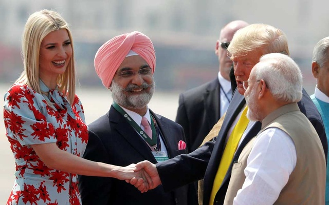 US President Donald Trump greets US White House senior advisor Ivanka Trump next to Indian Prime Minister Narendra Modi as they arrive at Sardar Vallabhbhai Patel International Airport in Ahmedabad, India Feb 24, 2020. REUTERS