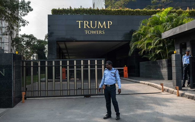 A security guard outside stands outside the Trump-branded 23-story complex in Pune, India, Feb 11, 2020. India has the largest number of Trump Towers outside North America, but sales are cool in an ailing market for luxury real estate. The New York Times