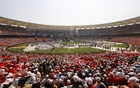 People sit in stands at the Sardar Patel Stadium, where US President Donald Trump addresses a