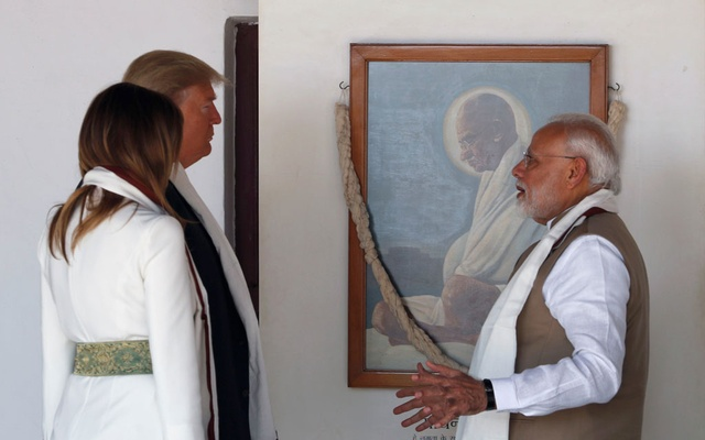 Indian Prime Minister Narendra Modi talks to US President Donald Trump and first lady Melania Trump as they visit the Gandhi Ashram in Ahmedabad, India Feb 24, 2020. REUTERS