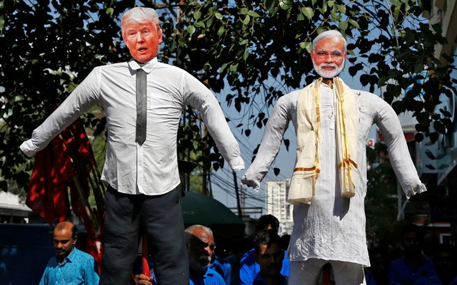 Supporters of Centre of India Trade Union (CITU) carry effigies depicting US President Donald Trump and India's Prime Minister Narendra Modi during a protest against Trump's visit to India, in Kochi, India, Feb 24, 2020. REUTERS