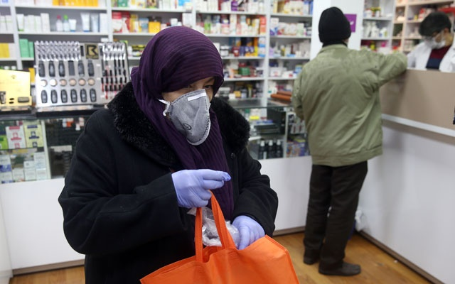 An Iranian woman wears a protective mask to prevent contracting coronavirus, as she is seen at a drug store in Tehran, Iran February 25, 2020. WANA (West Asia News Agency)/Nazanin Tabatabaee via REUTERS