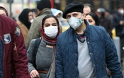 Iranian couple wearing protective masks to prevent contracting a coronavirus walk at Grand Bazaar in Tehran, Iran Feb 20, 2020. WANA (West Asia News Agency)/Nazanin Tabatabaee via REUTERS
