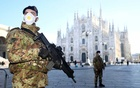 Military officers wearing face masks stand outside Duomo cathedral, closed by authorities due to a coronavirus outbreak, in Milan, Italy February 24, 2020. Reuters