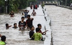 Children play in floodwaters at the Pondok Maharta residence, Tangerang, near Jakarta, Indonesia, Feb 25, 2020 in this photo taken by Antara Foto. Antara Foto/Rivan Awal Lingga/ via REUTERS