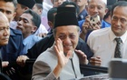 Malaysian Prime Minister Mahathir Mohamad gestures to his well-wishers before leaving a mosque after Friday prayers in Putrajaya near Kuala Lumpur Oct 31, 2003. REUTERS
