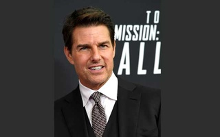 Actor Tom Cruise poses for photographers as he arrives on the red carpet for the premiere of Mission:Impossible-Fallout, at the Smithsonian's National Air and Space Museum, in Washington, US, Jul 22, 2018. REUTERS